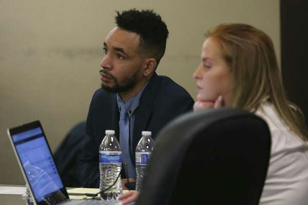 Former Ballet San Antonio star Hugo Ihosvany Rodriguez, left, sits with his defense team including Stacie Deline, right, on Tuesday.