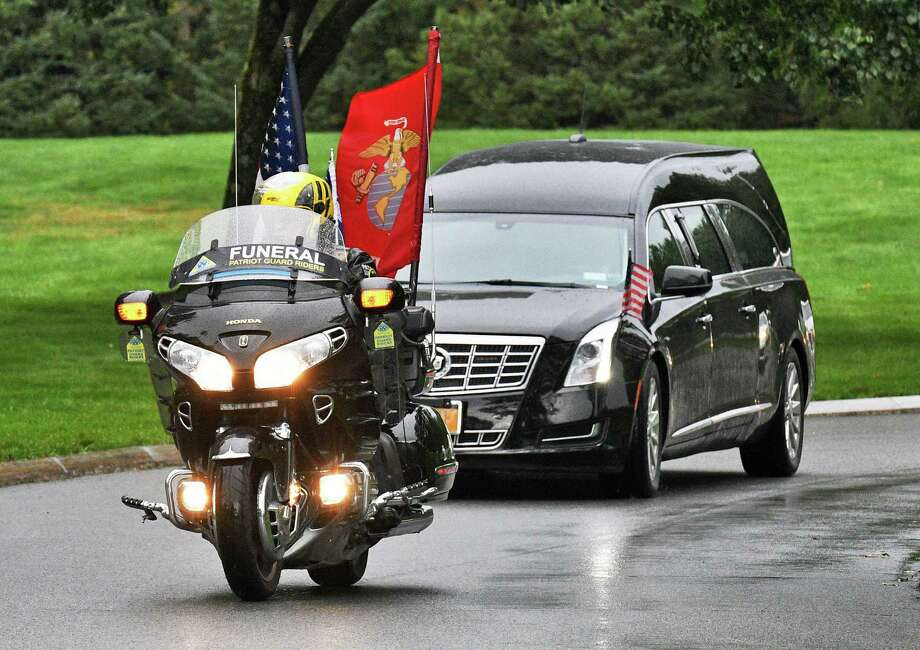 A Patriot Guard rider flying both an American and Marine Corps flags escorts a hearse carrying the remains of Schoharie limo crash victim Michael Christopher Ukaj at Gerald B.H. Solomon National Cemetery Wednesday Oct. 17, 2018 in Schuylerville, NY.  (John Carl D'Annibale/Times Union) Photo: John Carl D'Annibale, Albany Times Union / 20045140A