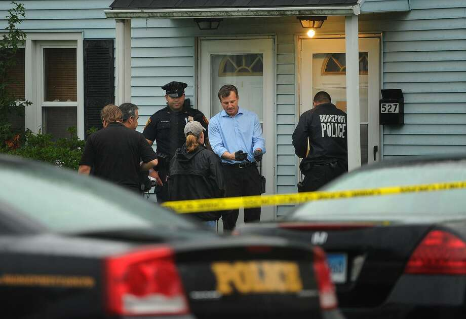 Lieutenant Chris LaMaine, center and Bridgeport Police prepare to enter the scene at 527 Pearl Harbor Street in Bridgeport, Conn. on Monday, August 13, 2018. Photo: Brian A. Pounds / Hearst Connecticut Media / Connecticut Post