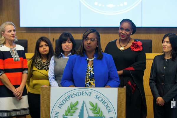 In this October 2018 file photo, Houston Independent School District trustees (LtoR) Sue Deigaard, Elizabeth Santos, Diana Dávila, Wanda Adams and Anne Sung listen as Grenita Lathan addresses the media during a press conference at the Hattie Mae White Educational Support Center. Trustees apologized for the recent turmoil among the school board and stated that Lathan would continue to serve as the interim superintendent.