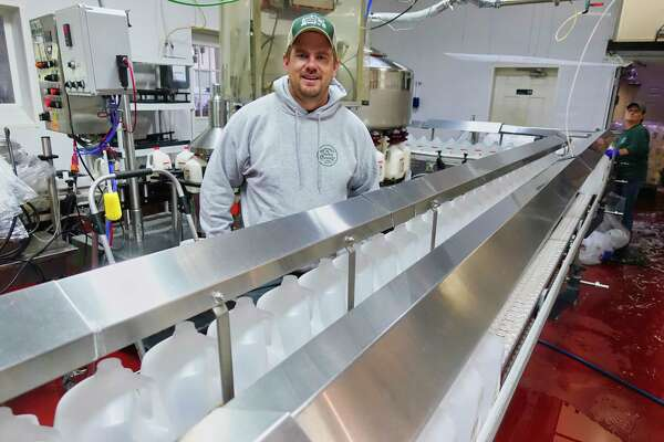 Seth McEachron stands next to the milk line at Battenkill Valley Creamery on Tuesday, Oct. 16, 2018, in Salem, N.Y. (Paul Buckowski/Times Union)