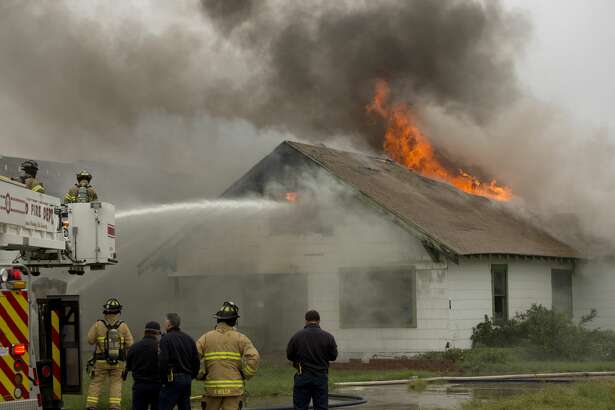 Midland firefighters battle a house fire 10/17/18 in the 3000 block of W. Michigan. Tim Fischer/Reporter-Telegram