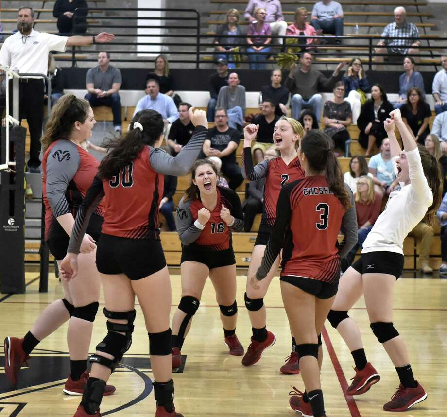 The Cheshire volleyball team, ranked No. 3 in the Top 10 coaches poll, celebrates a point against Amity in a match on Sept. 28. Photo: Peter Hvizdak / Hearst Connecticut Media / New Haven Register