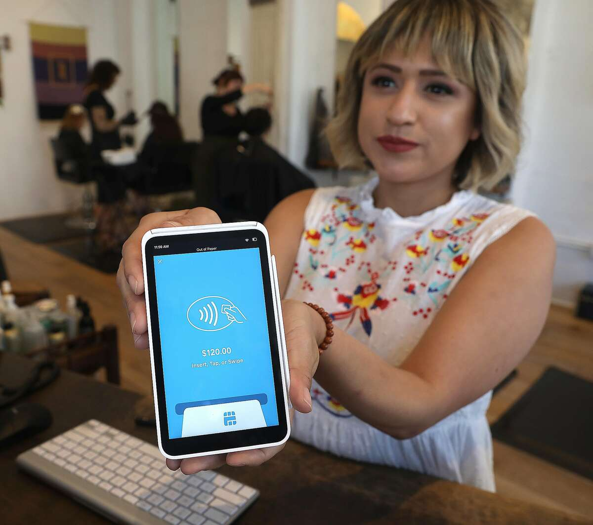 Manager Kat Berumen uses the new Square portable tablet at Edo salon on Wednesday, Oct. 17, 2018 in San Francisco, Calif. Square on Thursday will be announcing their new hardware--a portable tablet register that can be brought to customers to pay for a service.