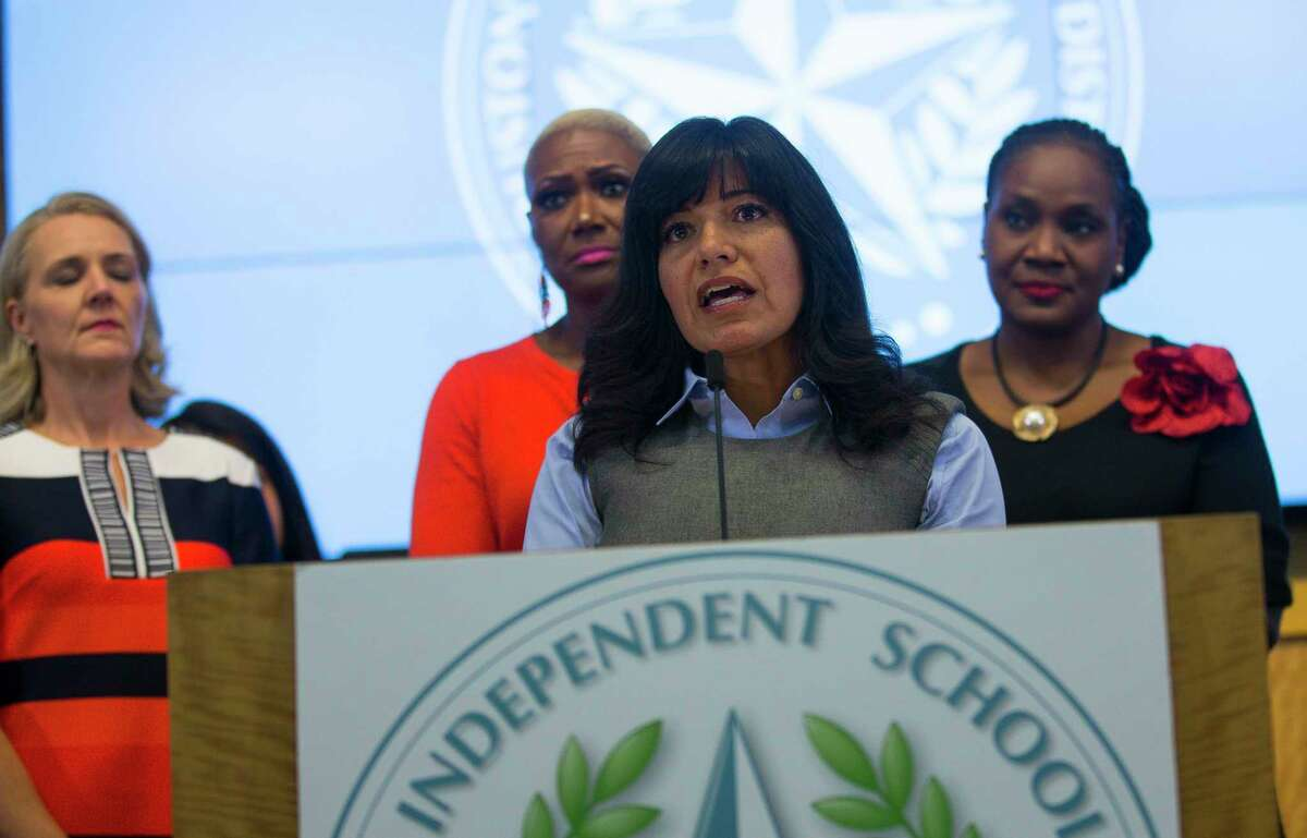 In this October 2018 file photo, Houston ISD Trustee Diana Dávila addresses the media with her fellow trustees during a press conference at the Hattie Mae White Educational Support Center in Houston. Texas Education Agency investigators issued a final recommendation Wednesday to strip power from HISD board members and appoint a new governance team.
