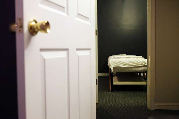 A massage room and bed at the Acupuncture Happy Center in San Francisco, CA, Friday, March 14, 2014. Inspectors with the San Francisco Department of Public Health, working in tandem with the SFPD's Special Victims Unit and SFFD building inspectors, conducted unannounced inspections of a select group of massage parlors in San Francisco looking for violations, sexual misconduct and evidence of human trafficking.