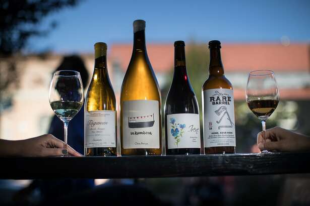 Customers Jessica Rix and Maria Chopivsky with some of the select wines served by Fool's Errand, on Friday, Oct. 12, 2018, in San Francisco, Calif.