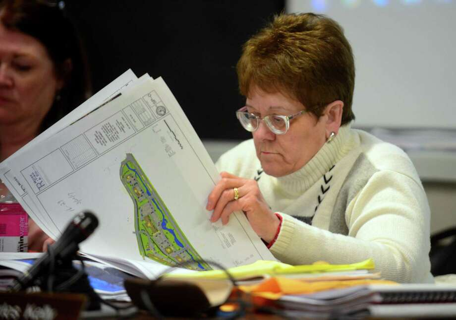Shelton Planning and Zoning Commission Chairwoman Virginia Harger looks over plans for the proposed Wells Hollow development during a public hearing held at City Hall in Shelton, Conn. on Wednesday Mar. 22, 2017. Members of SOS (Save Our Shelton) are against the proposed development which includes over 125 apartments, a hotel, 3 retail shops and 5 restaurants across from Towne Center at Shelton Ridge. Photo: Christian Abraham / Hearst Connecticut Media / Connecticut Post