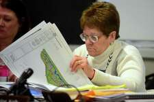Shelton Planning and Zoning Commission Chairwoman Virginia Harger looks over plans for the proposed Wells Hollow development during a public hearing held at City Hall in Shelton, Conn. on Wednesday Mar. 22, 2017. Members of SOS (Save Our Shelton) are against the proposed development which includes over 125 apartments, a hotel, 3 retail shops and 5 restaurants across from Towne Center at Shelton Ridge.