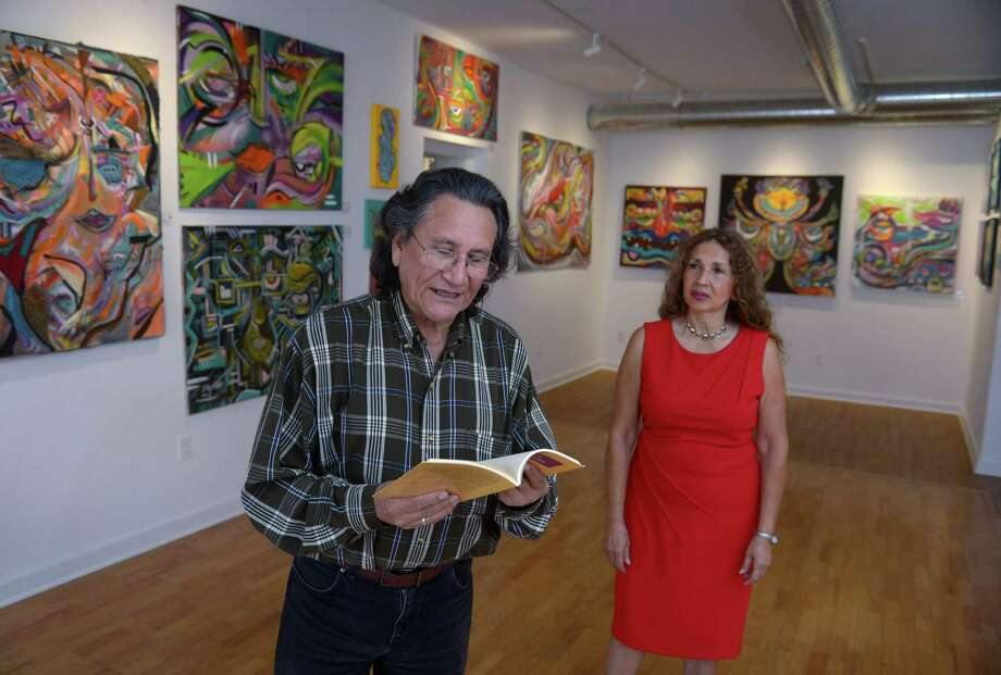 Husband and wife poetry team, Carlos Mavila and Ana Cecilia Zapata, at the Rene Soto Gallery Wednesday, October 17, 2018, in Norwalk, Conn. The Rene Soto Gallery hosts multilingual poetry readings monthly with Mavila and Rodriguez featured on Oct. 21. Photo: Erik Trautmann / Hearst Connecticut Media / Norwalk Hour