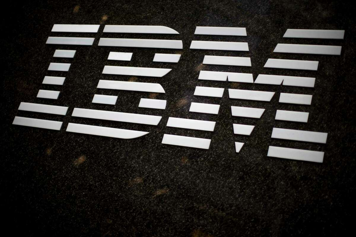 FILE- In this April 26, 2017, file photo, the IBM logo is displayed on the IBM building in Midtown Manhattan, in New York. IBM Corp. reports earnings Tuesday, Oct. 16, 2018. (AP Photo/Mary Altaffer, File)