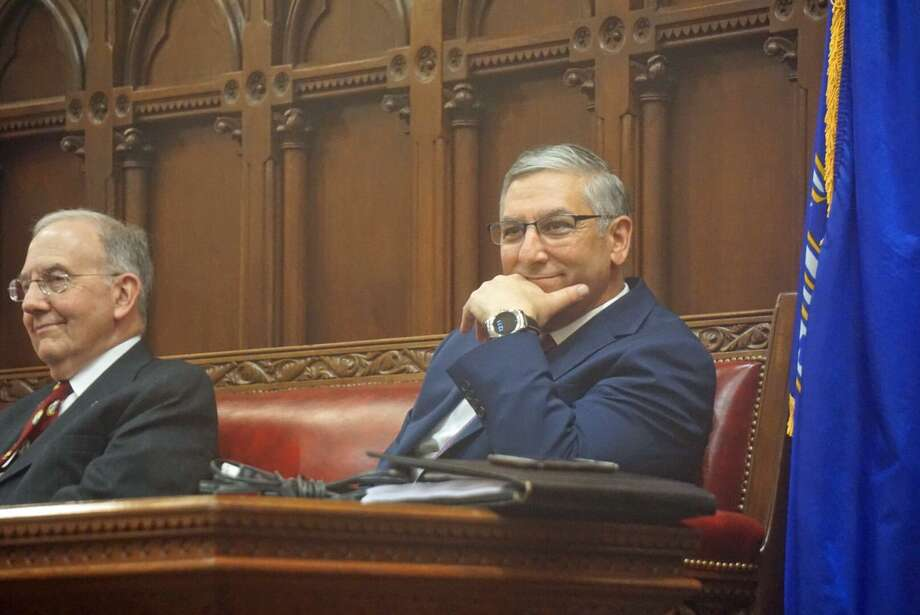 Senate Republican Leader Len Fasano, R-North Haven, right, sat with Senate President Pro Tempore Martin Looney, D-New Haven, leaving a space between them at the close of the 2018 legislative session at the Capitol in Hartford, Conn. Photo: Emilie Munson / Hearst Connecticut Media