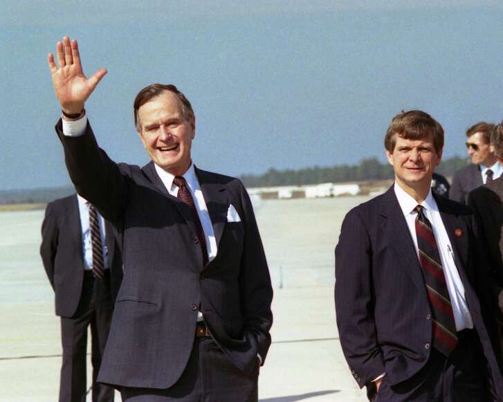 Political operative Lee Atwater accompanies President George Bush to Columbia, South Carolina in 1989. A reader says Atwater didn't invent dirty politics.