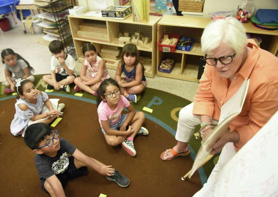 Joanne Spiel reads to her class of rising kindergartners at Gateway School in Greenwich, Conn. Wednesday, Aug. 8, 2018. Gateway School is the only all-day, all-year preschool, operated through Family Centers. Photo: File / Tyler Sizemore / Hearst Connecticut Media / Greenwich Time