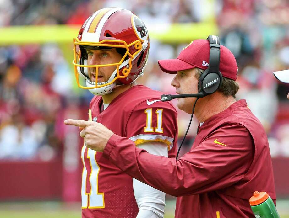 74991ec51 Redskins coach Jay Gruden wants quarterback Alex Smith to get the ball out  of his hands