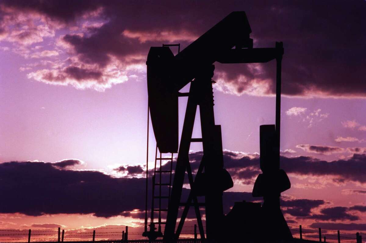 A pump jack outside of Midland, Texas, is silhouetted against the West Texas sunset.