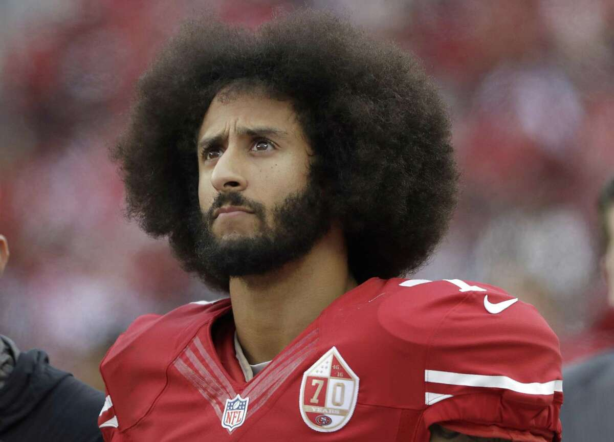 San Francisco 49ers quarterback Colin Kaepernick stands in the bench area during the second half of the team's NFL football game against the New York Jets in Santa Clara, Calif.