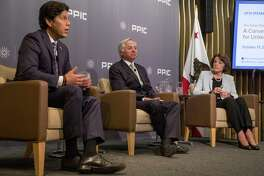 California State Senator Kevin De Leon, left, and U.S. Senator Dianne Feinstein, right, face off during a United States Senate debate moderated by Public Policy Institute of California CEO and President Mark Baldassare, center, held at the Public Policy Institute of California in San Francisco, Calif. Wednesday, Oct. 17, 2018.