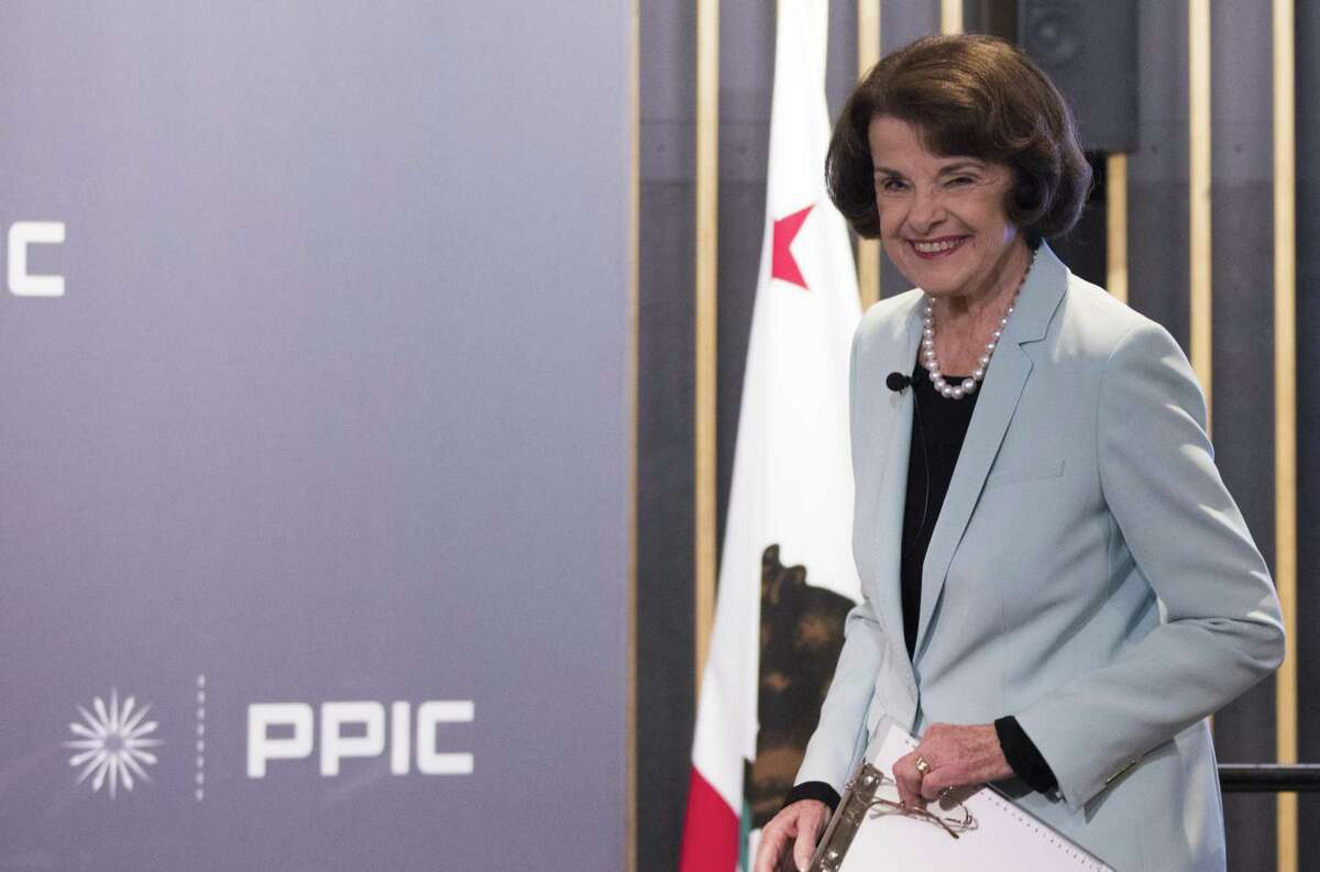 U.S. Senator Dianne Feinstein arrives to attend a United States Senate debate with California State Senator Kevin De Leon moderated by Public Policy Institute of California CEO and President Mark Baldassare, center, held at the Public Policy Institute of California in San Francisco, Calif. Wednesday, Oct. 17, 2018.