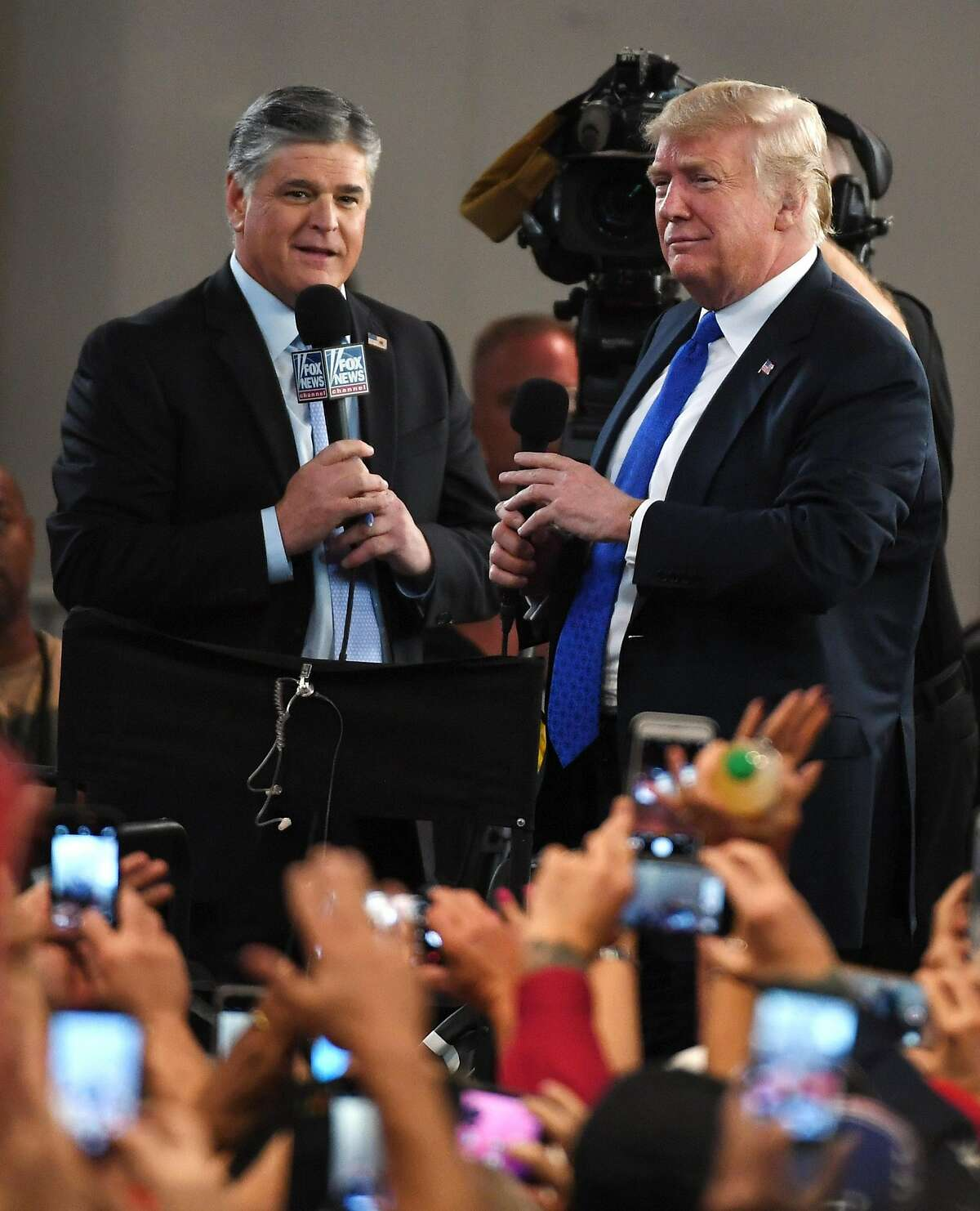 LAS VEGAS, NV - SEPTEMBER 20: Fox News Channel and radio talk show host Sean Hannity (L) interviews U.S. President Donald Trump before a campaign rally at the Las Vegas Convention Center on September 20, 2018 in Las Vegas, Nevada. (Photo by Ethan Miller/Getty Images)