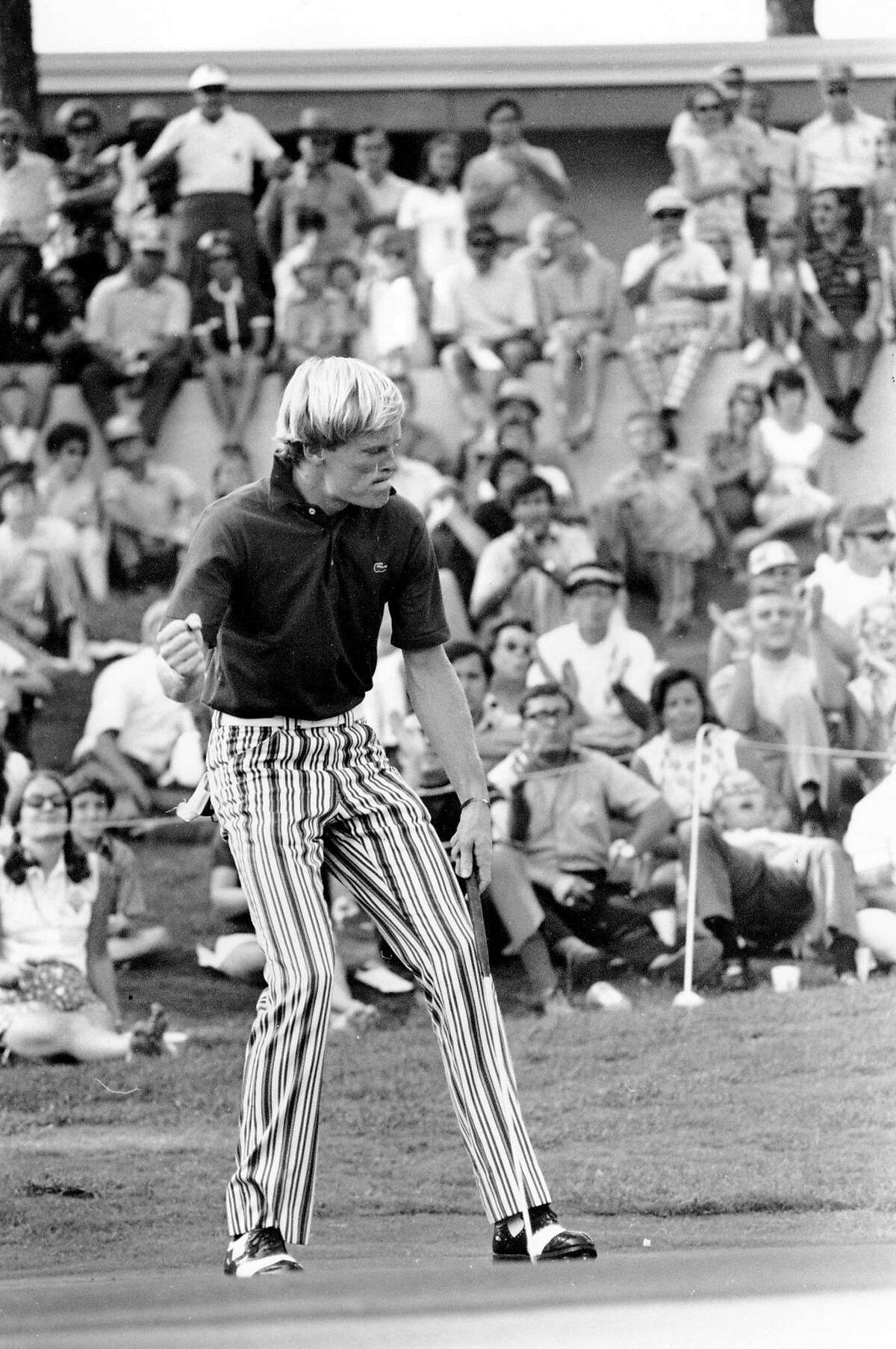 Johnny Miller, 23, reacts as his putt for a bird falls in on No. 18 at the Southern Open Championship at Green Island Club in Columbia, Ga., on Sept. 12, 1971. The birdie gave Miller a 13 under par total for the event. It is his first tour win. (AP Photo)