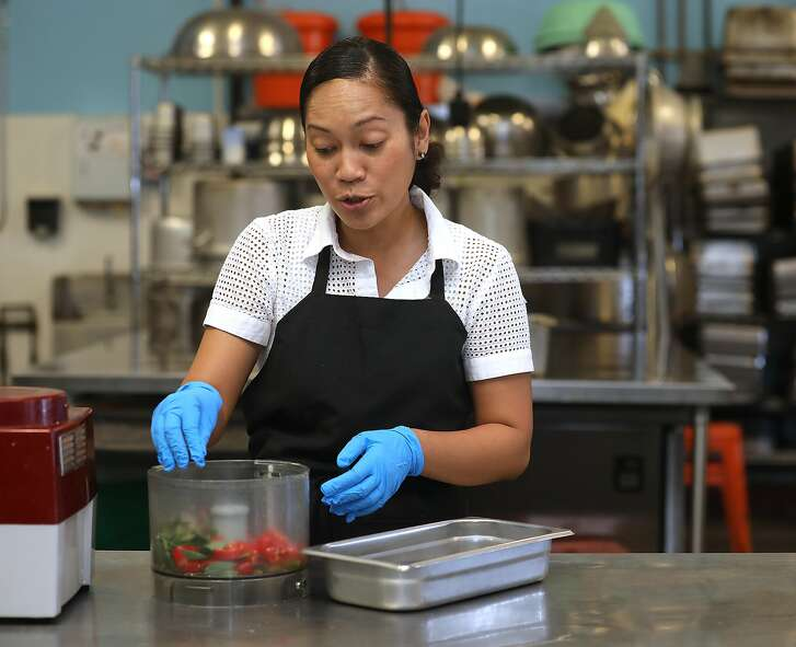 Chef/owner Siska Silitonga Marcus of Chili Cali uses a processor to help make a small batch of her sambal sauce on Friday, Sept. 7, 2018, in San Francisco, Calif.