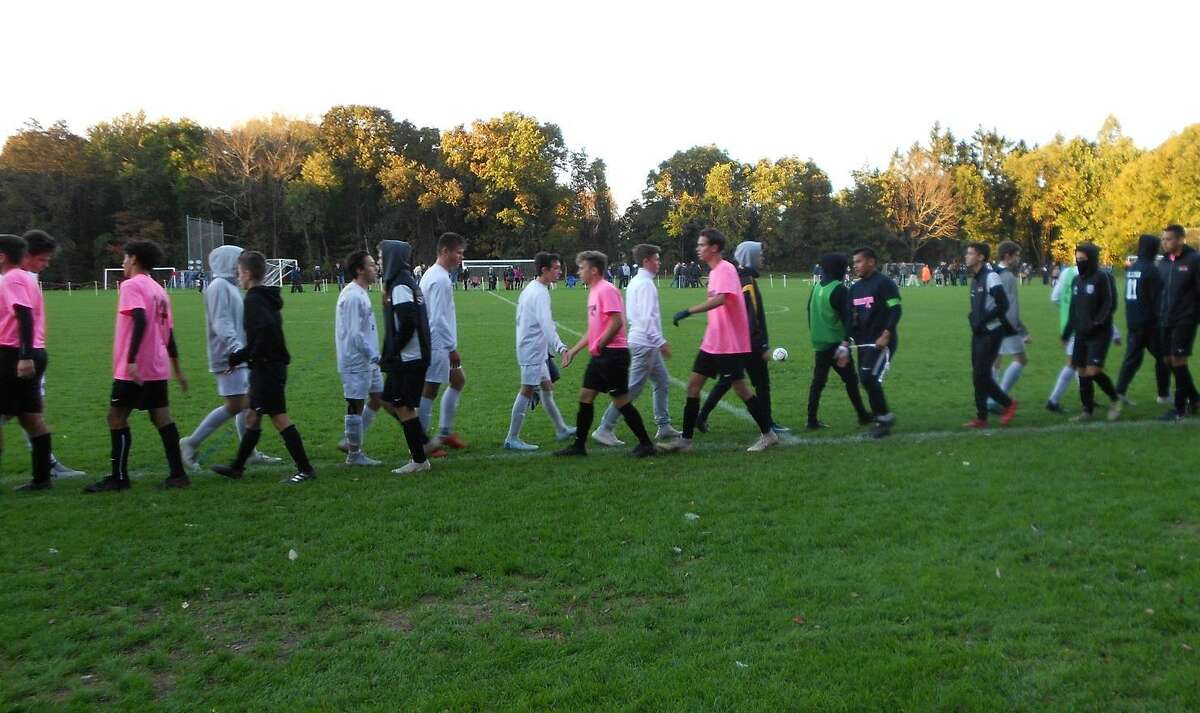 The teams shake after Hand's 3-2 win over Shelton in SCC boys soccer at Capewell Park
