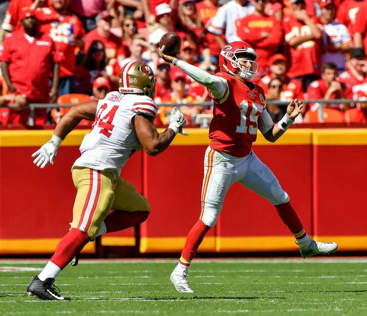 Kansas City Chiefs quarterback Patrick Mahomes throws on the run and under pressure from San Francisco 49ers defensive end Solomon Thomas in the second half on Sunday, Sept. 23, 2018 at Arrowhead Stadium in Kansas City, Mo. (John Sleezer/Kansas City Star/TNS)