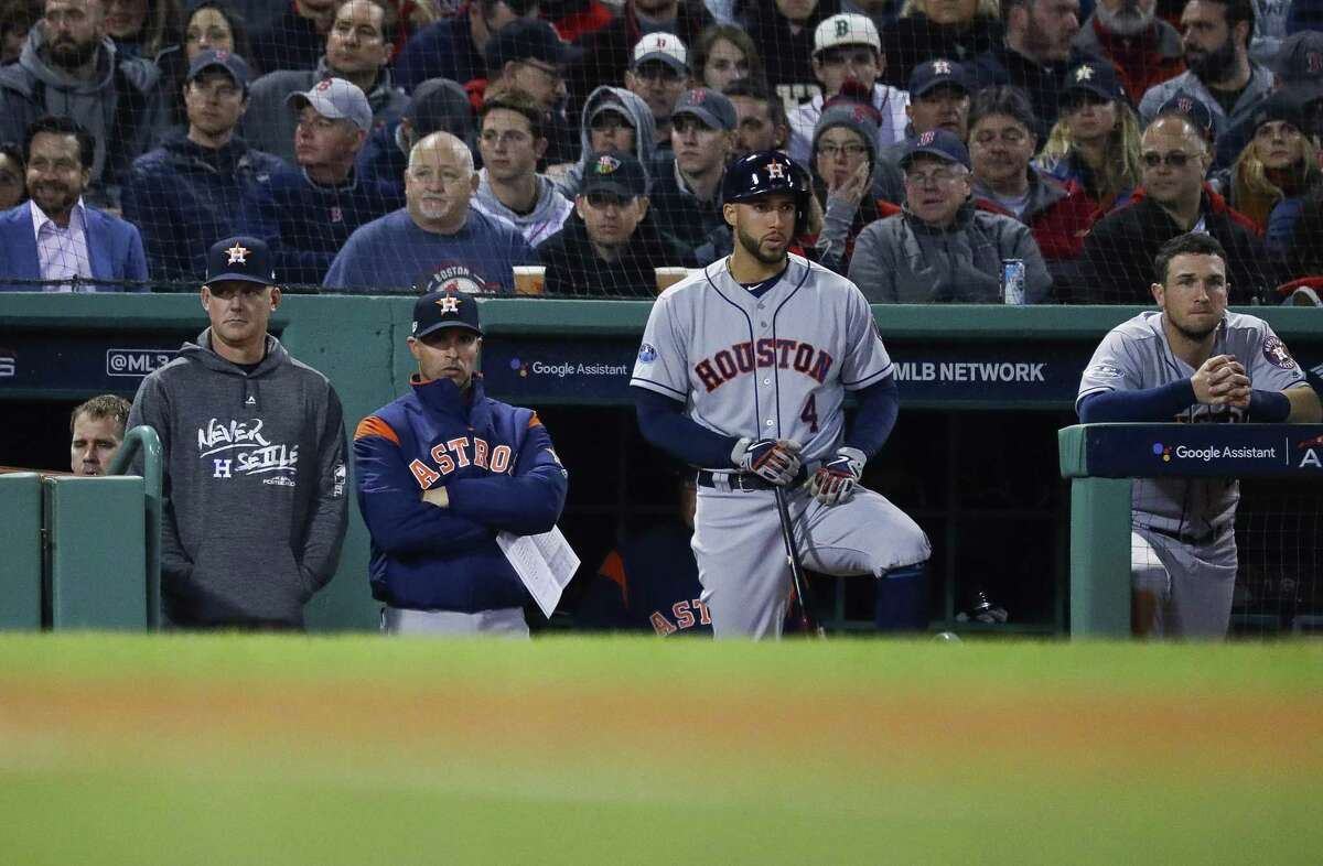 Astros manager A.J. Hinch and bench coach Joe Espada watch the game with George Springer and Alex Bregman during Game 2 of the American League Championship Series at Fenway Park on Sunday, Oct. 14, 2018, in Boston.