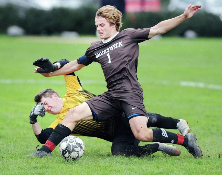 Brunswick's Harry Barringer, center, plays a rebound off a block by Salisbury goalie Jonah Anderson during the boys high school soccer match between Brunswick School and Salisbury School at Brunswick in Greenwich, Conn., Wednesday, Oct. 17, 2018. Barringer did not score on his shot attempt. Photo: Bob Luckey Jr. / Hearst Connecticut Media / Greenwich Time