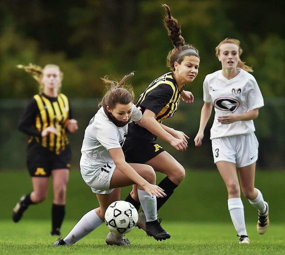 Amity's Julia Potter battles Cheshire's Isabelle Pellegrino during SCC action on Wednesday. Amity won 2-1. Photo: Catherine Avalone / Hearst Connecticut Media / New Haven Register