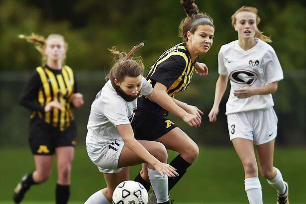 Amity's Julia Potter battles Cheshire's Isabelle Pellegrino during SCC action on Wednesday. Amity won 2-1.