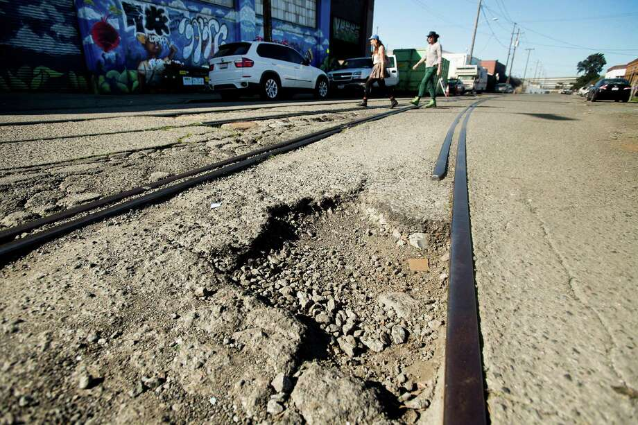 A pothole in Oakland. Click through the gallery to read about the amount of money drivers in various cities spend on maintenance because of bad roads, plus a look at the worst roads overall. Photo: Noah Berger / Special To The Chronicle / online_yes