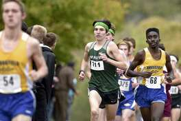 New Milford's Eli Nahom (311) finished first in the boys SWC cross country championships Wednesday with a time of 16:16.07.