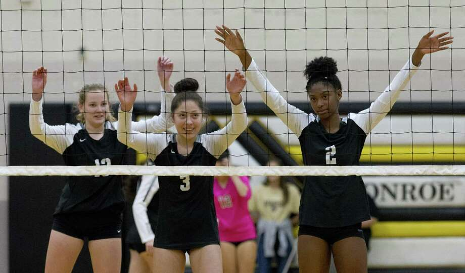 Conroe outside hitter Neena Landis (13), outside hitter Amanda Rivera (3) and middle blocker Mikayla Anderson (2) are seen before a serve during the first set of a District 15-6A high school volleyball match at Conroe High School, Wednesday, Oct. 17, 2018, in Conroe. Photo: Jason Fochtman, Houston Chronicle / Staff Photographer / © 2018 Houston Chronicle