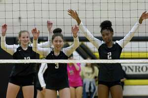 Conroe outside hitter Neena Landis (13), outside hitter Amanda Rivera (3) and middle blocker Mikayla Anderson (2) are seen before a serve during the first set of a District 15-6A high school volleyball match at Conroe High School, Wednesday, Oct. 17, 2018, in Conroe.