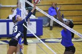Staples Isabella Jagenberg (19) finger taps the ball as Darien Hassana Arbubakrr (12) defends in an FCIAC girls volleyball match in Darien, Connecticut., Wednesday, Oct. 17, 2018.