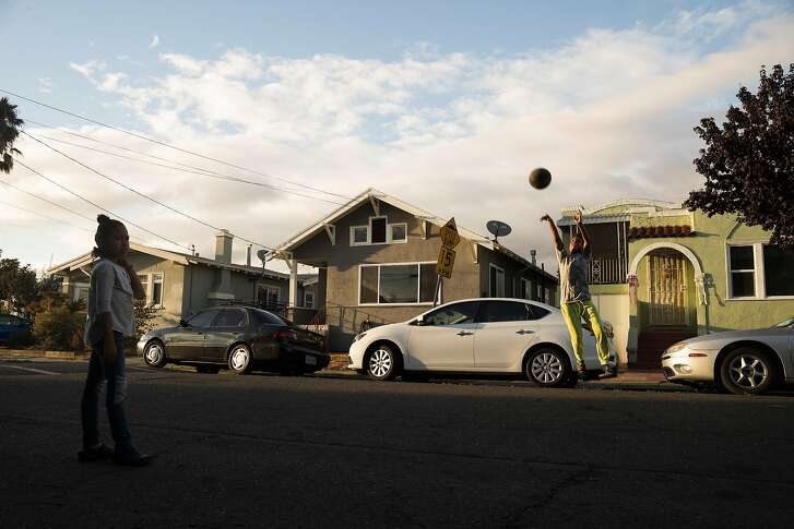 A street in Oakland, Calif., where private equity firms have been buying up single-family homes and turning them into rentals, Oct. 3, 2018. In the midst of a dire affordable housing crisis, heavy sums are being spent on Proposition 10, alternately seen as a much-needed tool to help cities, or a radically misguided idea that will only worsen matters. (Brian L. Frank/The New York Times)