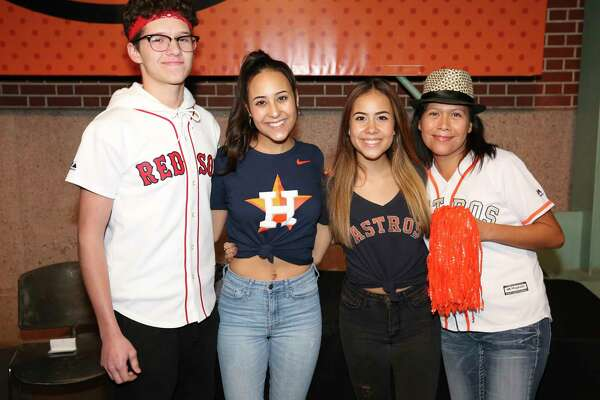 Houston Astros fans pose for a photograph before Game 4 of the American League Championship Series at Minute Maid Parkon Wednesday, Oct. 17, 2018, in Houston.