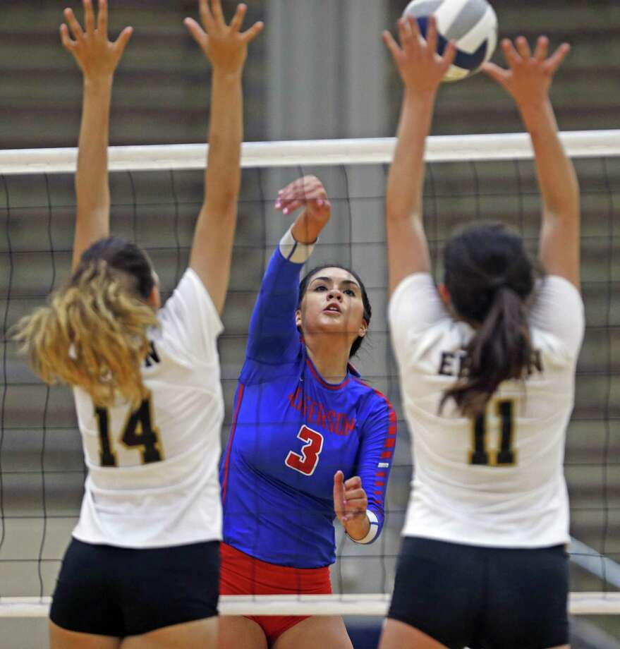 Jefferson's Noelia Rocha,C slams the ball past Edison's Natalie Esqueda,L and Bailey Barnes from the District 27-5A high school volleyball match between Jefferson and Edison on Tuesday, September 18, 2018 at Alamo Convocation Center. Photo: Ronald Cortes, Photo Correspondent / 2018 Ronald Cortes