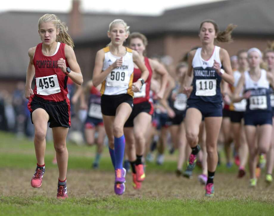 Pomperaug's Kate Wiser (455) leads the pack at the start of the girls SWC cross country championships, Wednesday afternoon, October 17, 2018, at Bethel High School, Bethel, Conn. Wiser finished first in 17:40.1. Photo: H John Voorhees III / Hearst Connecticut Media / The News-Times