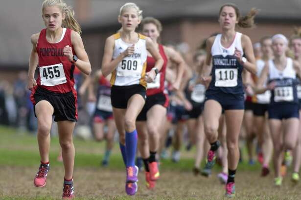 Pomperaug's Kate Wiser (455) leads the pack at the start of the girls SWC cross country championships, Wednesday afternoon, October 17, 2018, at Bethel High School, Bethel, Conn. Wiser finished first in 17:40.1.