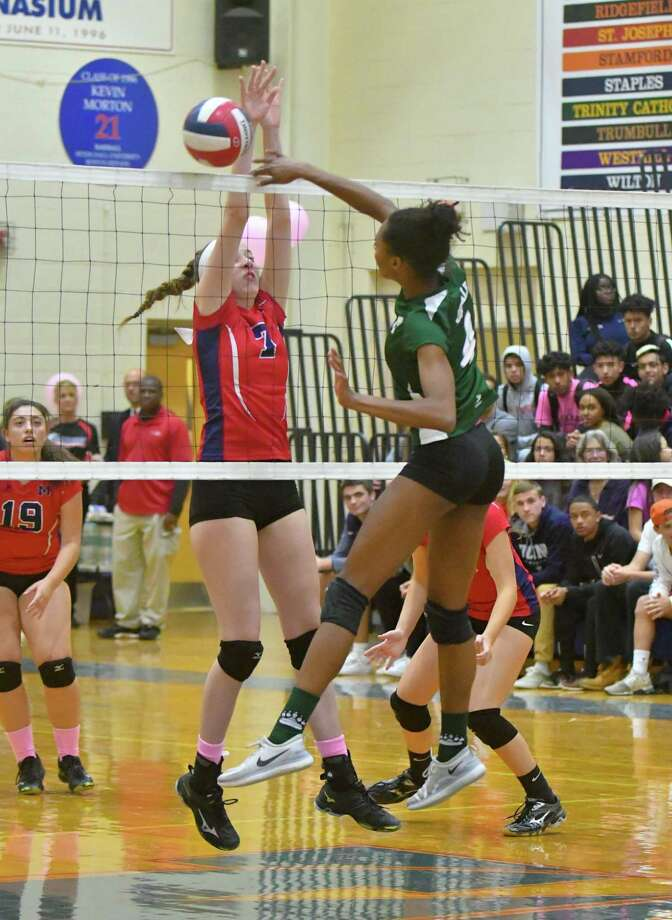Norwalk's Naeva Rene (4) hits a kill shot during Wednesday's game against Brien McMahon at Brien McMahon High School in Norwalk. Photo: Gregory Vasil / For Hearst Connecticut Media / Connecticut Post Freelance