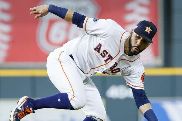 Houston Astros Marwin Gonzalez (9) catches a grounder by Boston Red Sox Andrew Benintendi (16) during the first inning of Game 4 of the American League Championship Series at Minute Maid Park on Wednesday, Oct. 17, 2018, in Houston.