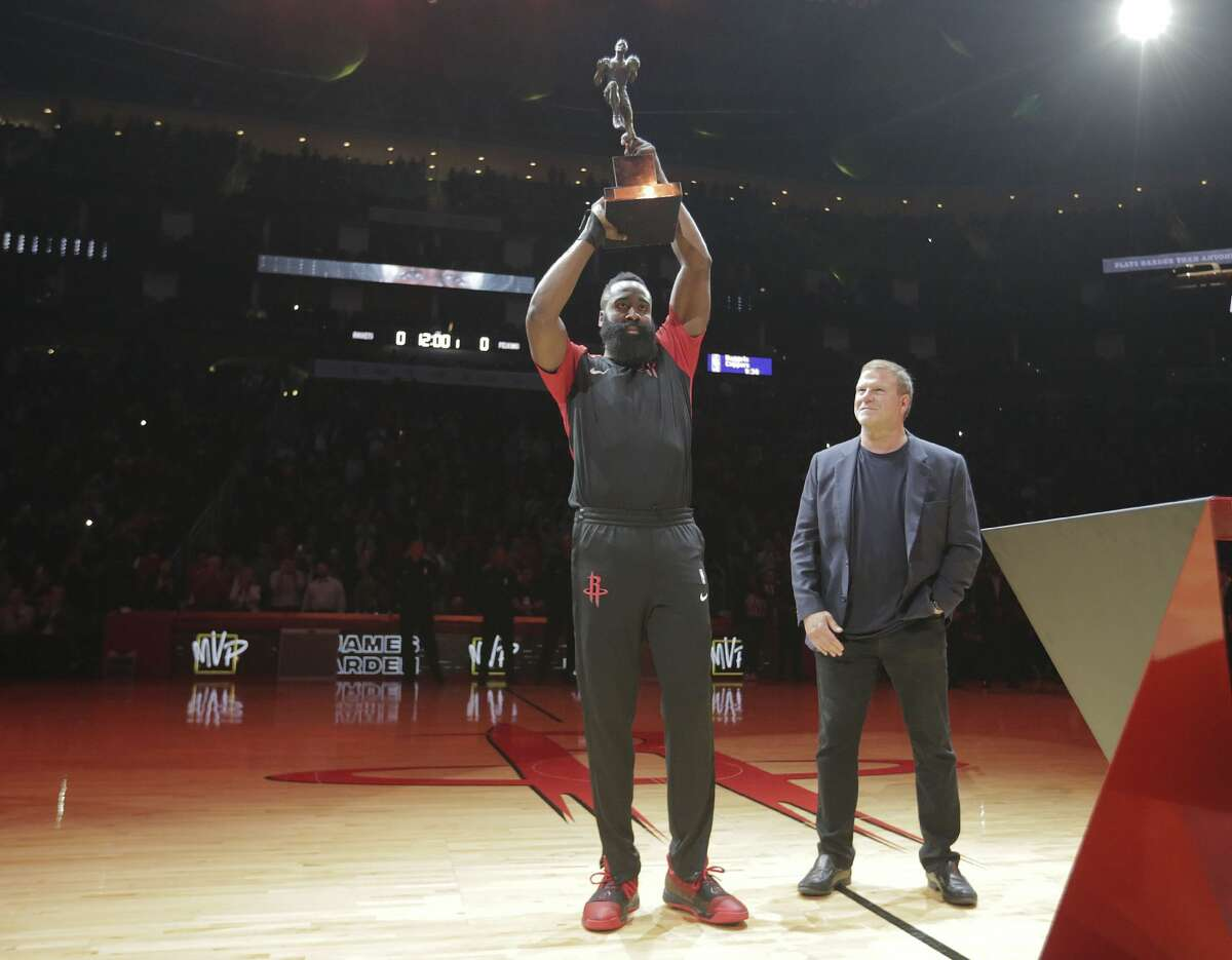 James Harden, accepting the trophy from owner Tilman Fertitta on opening night, became the third Rockets player to win NBA MVP honors.