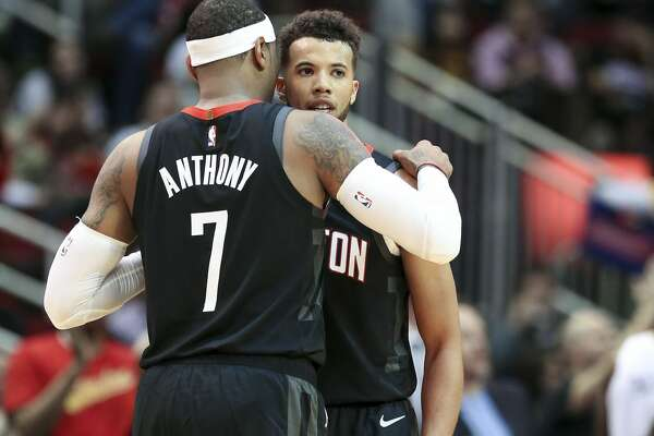 Houston Rockets forward Carmelo Anthony (7) talks with Houston Rockets guard Michael Carter-Williams (1) during a time out at the Toyota Center on Wednesday, Oct. 17, 2018 in Houston.