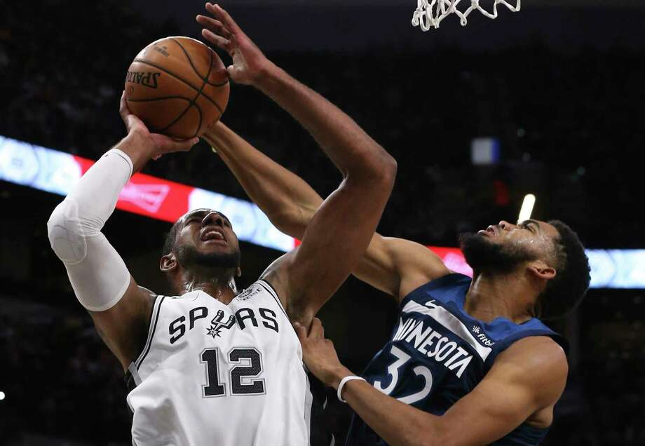 San Antonio Spurs' LaMarcus Aldridge goes for two against Minnesota Timberwolves' Karl-Anthony Towns during the first half at the AT&T Center, Wednesday, Oct. 17, 2018. Photo: JERRY LARA, San Antonio Express-News / © 2018 San Antonio Express-News