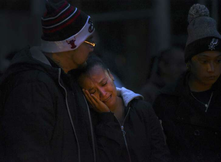 Patricia Slack, mother of Charles Roundtree, an 18-year-old who was shot and killed in the 200 block of Roberts Street, weeps during a gathering to memorialize him. Roundtree was unarmed and was hit by a bullet fired at another person.