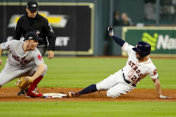 Houston Astros designated hitter Jose Altuve (27) safely reaches second base after hitting a double that bounced off of the left field wall during the third inning of Game 4 of the American League Championship Series at Minute Maid Park on Wednesday, Oct. 17, 2018, in Houston.