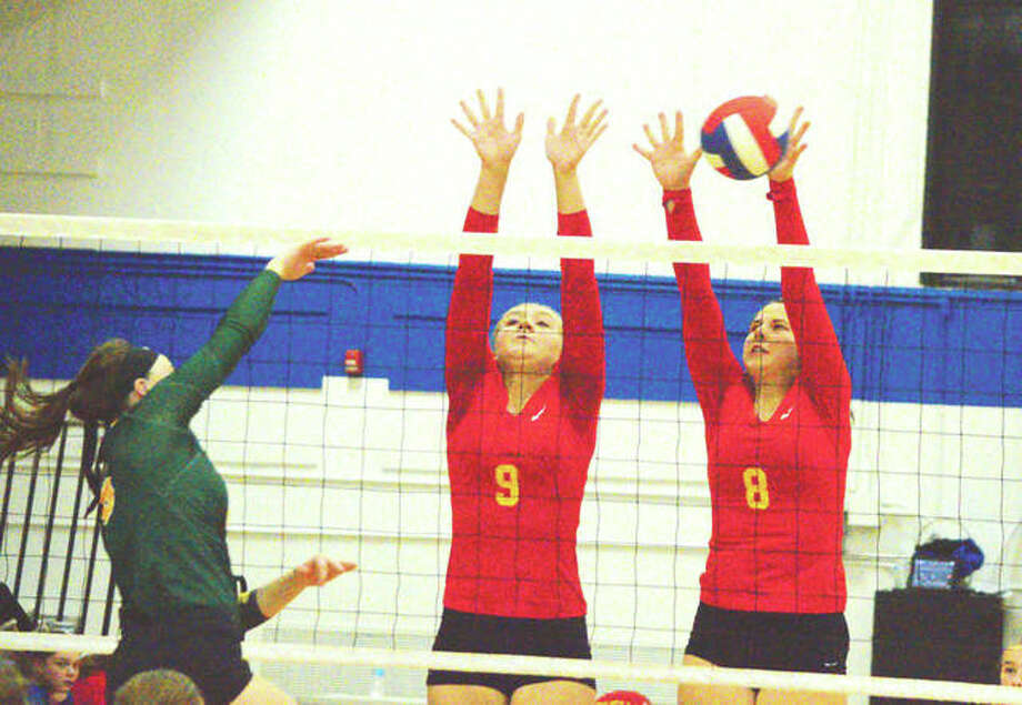 Roxana's Kiley Winfree (right) and Abi Stahlhut go up for a block during Wednesday's home match against Metro-East Lutheran. Photo: Scott Marion | For The Telegraph